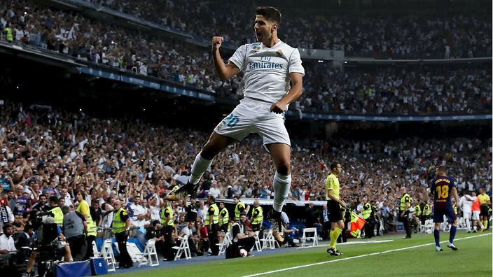 Real Madrid's Asensio celebrates a goal against Barcelona