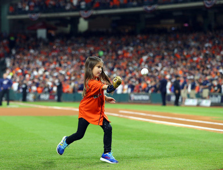 Hailey Dawson launches the first ball in the World Series