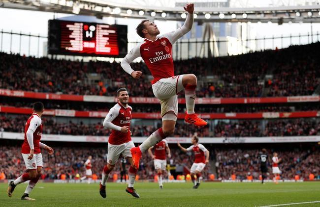 Arsenal players celebrating a goal at the Emirates Stadium