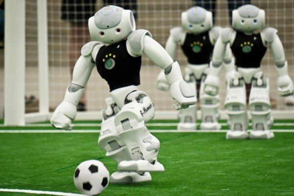 Robots playing soccer at the RoboCup