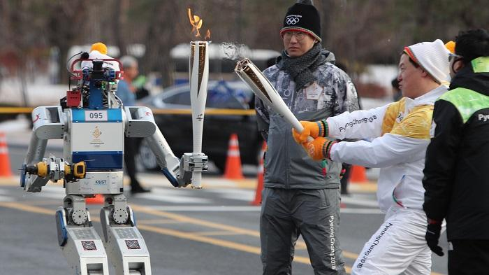 A robot carrying the Olympic torch