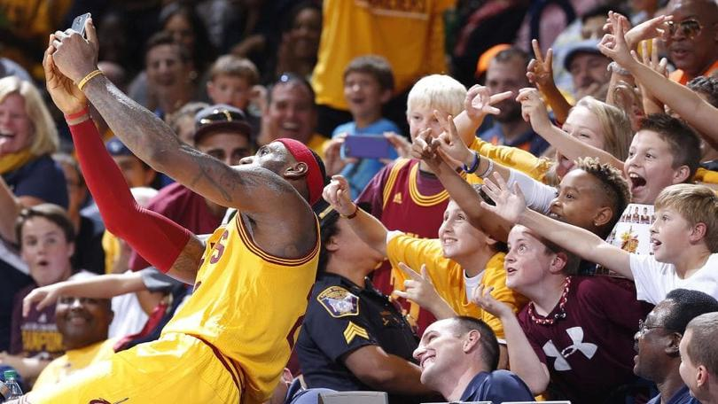 LeBron James taking a selfie with fans