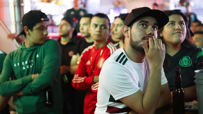 Mexican fans watching the World Cup