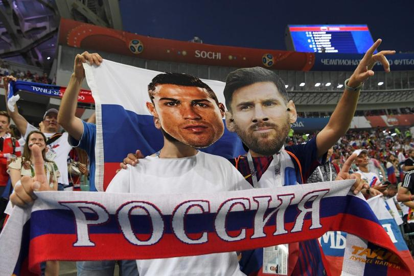 Fans at the World CUp 2018 with Cristiano Ronaldo and Lio Messi masks